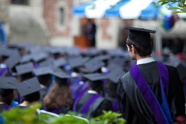 A graduate listens during the commencement at Yale Law School on May 23, 2011.
